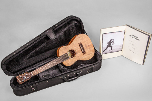 Bid on this Eddie Vedder package: autographed ukulele, deluxe-edition Ukulele Songs songbook, and U.S. tour tickets. It's for charity.