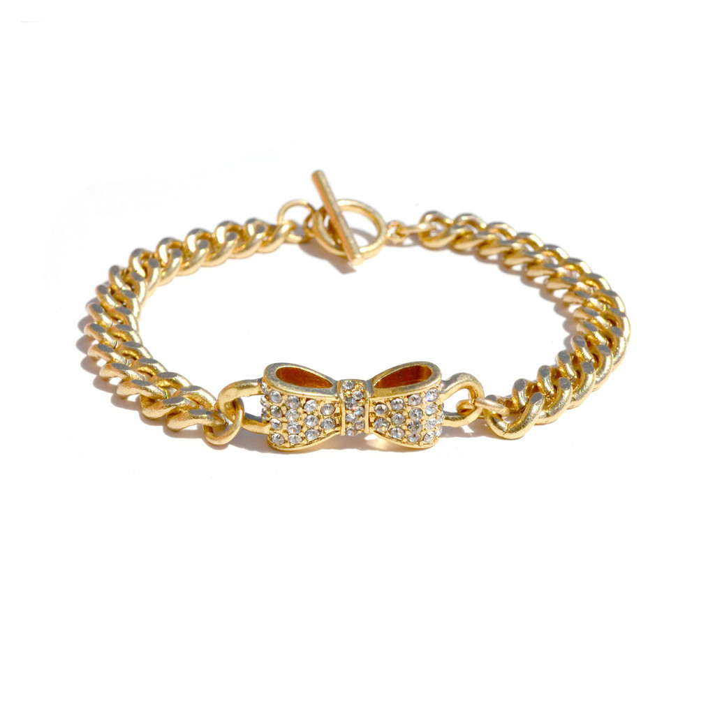 This gold bow bracelet from JEWELIQ is so cute! I want it.