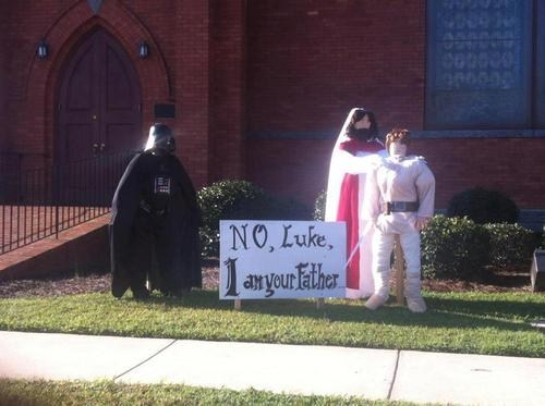 "Church's hilarious Halloween decoration pits Jesus against the darkest force in the universe.If we're going to work the bible into it, just make sure Jar Jar doesn't make it onto the ark. It's just a joke, sure, but in every good joke there's truth. ""A long time ago, in a galaxy far far away…"" Well, 2,000 years counts as a pretty long damn time ago, right? In one galaxy, rebels were battling an evil empire for their freedom. In another, a young man became a prophet of peace in an attempt to lead his people away from the forces of another evil empire called ""Sin."" All that would've had to happen was Vader goes chasing after Luke and the two of them lightspeed in the wrong direction, crash-land on Earth, Luke becomes the thirteenth apostle and Vader has to fight a guy way more powerful than Obi Wan Kenobi even though they shop at the same clothing store. Why couldn't this have been the plot of one of the prequels? Via Happy Place"