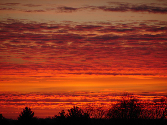 A Colorful Cloud-Filled Sunset by littlelori on Flickr.