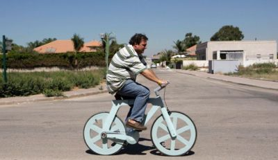 realcleverscience:  haaretz:  A bicycle made almost entirely of cardboard has the potential to change transportation habits from the world's most congested cities to the poorest reaches of Africa, its Israeli inventor says. Izhar Gafni's lightweight, cheap bicycle, made almost entirely of cardboard, can be given to poor for free and recycled if broken. Read more.  This is an amazing article and invention. In case you're wondering, they expect you'll be able to buy these for around $20 - but due to various government incentives, and advertising on the bike, they're hoping to be able to provide them for free in many poor areas! Really amazing stuff! Oh, and seems to be quite green! (Though I wouldn't mind some more info about that.) Check out the link, and also the video on that page! P.s. It's waterproof.