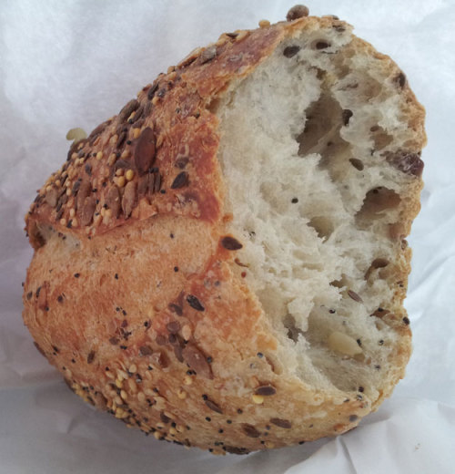 "rosepalazzolo:  The Best Bread in the World This is a loaf of pain aux cereales that I bought this morning from Maison Kayser on New York's Upper East Side. It's all gone. I thought I would just try a bite of it before I took it home as part of the dinner offerings for later. But I took one bite. And I couldn't stop. My hand just dug into the this bag and pulled away at it until the very last amazing nubby end was in my mouth. I read that David Lebovitz says that it's ""perhaps the best bread in the world."" And, um, this mofo thing is more than that. Amazing. It's crusty in the right way, tangy in the right way and full of texture in the right way. New Yorkers, go there now. Blow your mind and eat Eric Kayser's pain aux cereales."