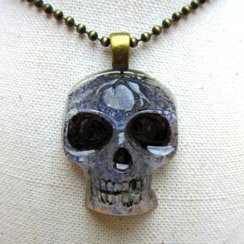 halloweencrafts:  DIY Resin Skull Pendant Tutorial from Dollar Store Crafts here. This project uses the Dollar Store skull ice cube tray.