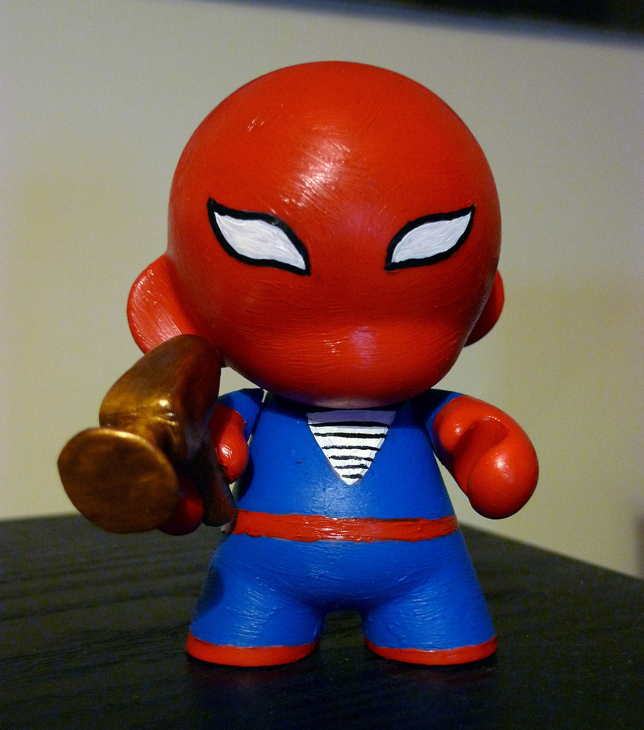 "Fan submission of a custom painted ""munny"" from Dave Tinkham. ""The result of a Sunday afternoon munny-painting session."""