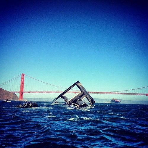 americascup:  #oracleteamusa #ac72 has drifted under #goldengatebridge #ebbtide (Taken with Instagram at San Francisco Bay)