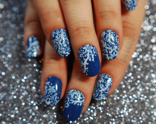 Donne painted this beautiful set for fashion house Tadashi Shoji's Nail Art Challenge. The Challenge was to create nails inspired by Tadashi's Spring Summer 2013 line of clothing. Our design was inspired by floral fabrics, tiles, and mosaic patterns. Essie polishes in Mesmerize and Borrowed & Blue, painted with a tiny brush and finished with Seche Vite top-coat were all the materials used to create this design.  You can vote for Hey, Nice Nails once a day in the Tadashi Shoji Nail Art Challenge by going to their Facebook Voting App HERE! While you're there…Go ahead and Like HNN on Facebook HERE! It was an honor to be chosen by Tadashi to participate along with our wonderful colleagues at The Illustrated Nail, The Nailasaurus, The Daily Nail, Chalkboard Nails, Nailed It, Polish You Pretty, & The Daily Polish!