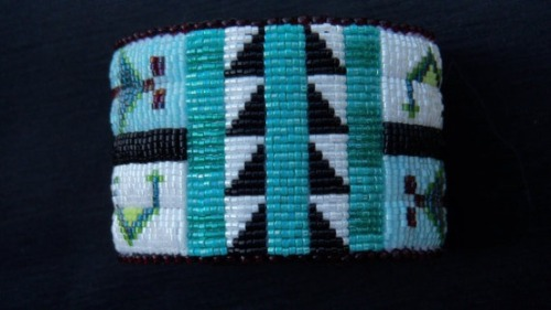 Posted by beyondbuckskin: Beaded Slap Bracelet in Blue Tribal Patterns by Molly Murphy Adams (Oglala Lakota descendant).