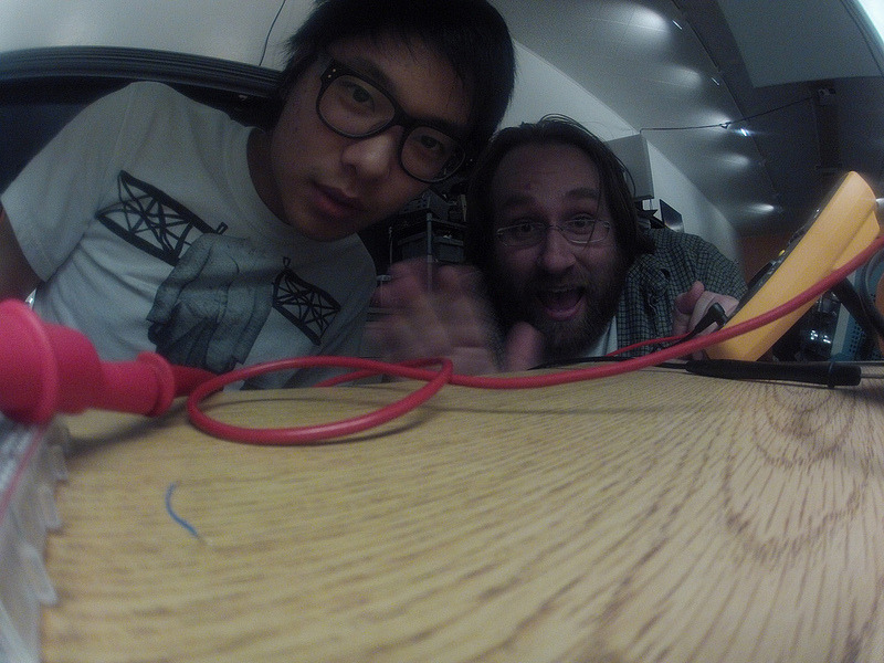 Recently my hetero life partner Colin Ho and I turned a Go Pro Hero into a lifelogger camera.  I've wanted to do life logging forever but never got my stuff together so when Colin brought in the camera in and made the challenge, I was in. Take a look at Colin's post, but basically,  we pulled some code, schematics and a pinout from this guy and set to implementing it all in one night at our hackerspace HeatSync Labs. I laid out the board in Eagle and etched it Colin did up all the mechanical designs (laser and 3d printed). The only speciality part we needed was an iPhone connector which, since this is a hackerspace, we had stashed around ;) The result is hosted on Our Git. Colin has been using the camera for ~3 weeks while traveling and Ive been using it for about a week. In my tests at approximately 2 pictures per minute I'm getting 18h hour battery life on a used old Go Pro Hero.  The daylight results are awesome. The camera placement with the fish eye lens is perfect. Im picking up conversation partners, meals, a great view of my laptop, phone, and any projects I'm hacking on.  The only problem is blurriness in ~50% of shots. Basically without knowing if the shot is being taken we're not staying still. We may want to turn on the Go Pro's audible beep again, or do something light or haptic based to notify of the impending shot, but theres an argument for not changing my life or becoming aware of when shots are being taken.  The real drawback so far has been the low light response which is TERRIBLE. Blurriness probably goes up over 75% especially if theres ANY motion. For a worst case scenario I took it out to a nightclub (where I drank and danced way too much for photos anyway) and only got maybe ten usable photos out of a thousand! This was an average GOOD shot! Still, I got ten awesome photos I wouldn't have had otherwise. To get around this I'm going to up my shot rate and expect to throw away half of my photos. Related: Anyone seen anything to detect and rate photos based on focus? Take a look at more results over at my flickr new server! Of note, the Hero 3 was just announced. It is half thickness from the Hero 2 and can do eight hours on intervalometer so we may just be able to use that camera out of the box without external modification. However, there may still be a reason for us to add some buttons and lights to make the hero a frendlyier life cam.  We're certainly happy enough with the results to keep playing!