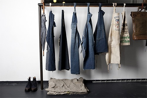 Denim overalls in Tenue de Nimes showroom