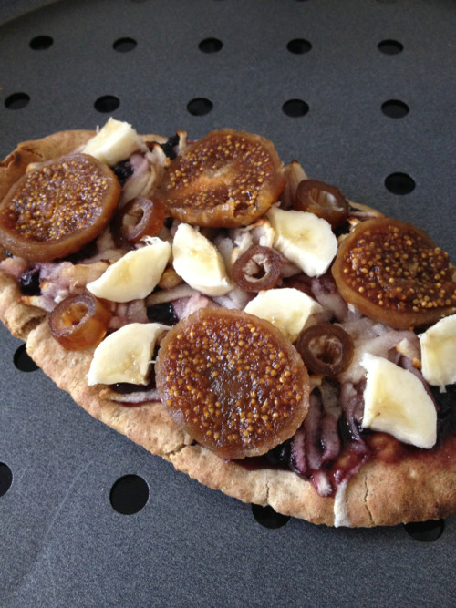 reblogged from returning-to-life:  I had a sweet pitta pizza for lunch. :3 I used blueberry jam as the sauce, grated apple as the cheese, dried figs as pepperoni, dates as olives and banana as… Um chicken? Some other pizza topping anyways. lol  Congress was wrong. Pizza is really a fruit.