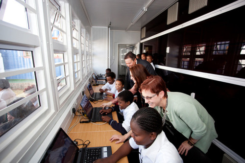 Shipping Container Computer Labs Connect Kids With Mentors Around The World   Shipping containers have become popular sites for repurposing in recent years—we've seen shipping container homes, gardens, even portable pizza shops. Architecture and design firm Perkins+Will is taking a different tack by turning 40-foot shipping containers into learning laboratories in South Africa. The LaunchPad computer labs, created in partnership with U.S. nonprofit Infinite Family, are intended to connect local kids with mentors around the world. Mentors talk weekly with South African kids affected by HIV/AIDs and poverty via computer to help them improve English skills, computer skills, interpersonal skills, and more.