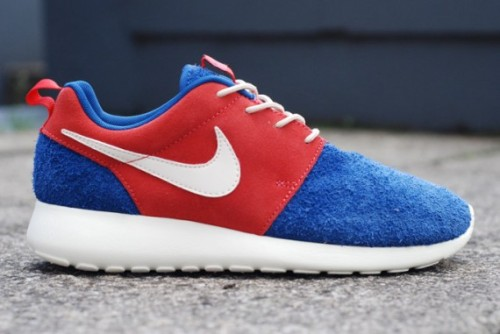 "Nike Roshe Run ""Pre Montreal"" We've seen several different variants of the Roshe Run and here's another about to hit retailers which is a bit different. The toe cap and heel is made up of a sport blue suede which is fuzzy and red side panels and pulls on the heel. The finer details stand out in white. Some have been speculating that this is inspired by this summer's Olympics.  Available from Crooked Tongues soon."