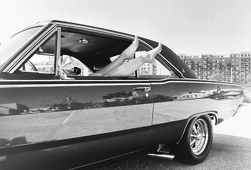 studiotolstoink:  1965 Dodge Dart GT  Couldn't avoid going back to back cars here. A little Mopar representation this time. While this is a great car, the beautiful feet sticking out the window are a much better reason to come in for a closer look. Wonder if we promised a foot massage, she'd let us take it for a spin.