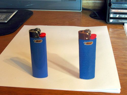 x3livelovelaugh:  'The lighter on the left is real and the one on the right is drawn on paper in a 3D' even my mother is tripping out.