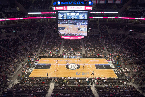 newyorker:   Last night, the Brooklyn Nets played their first home game at their new arena, the Barclays Center. As meaningless preseason exhibitions go, it was, without question, the most exciting one I've ever attended.  Read Reeves Wiedeman on the Barclays Center Experience. Photograph by John Minchillo/AP.