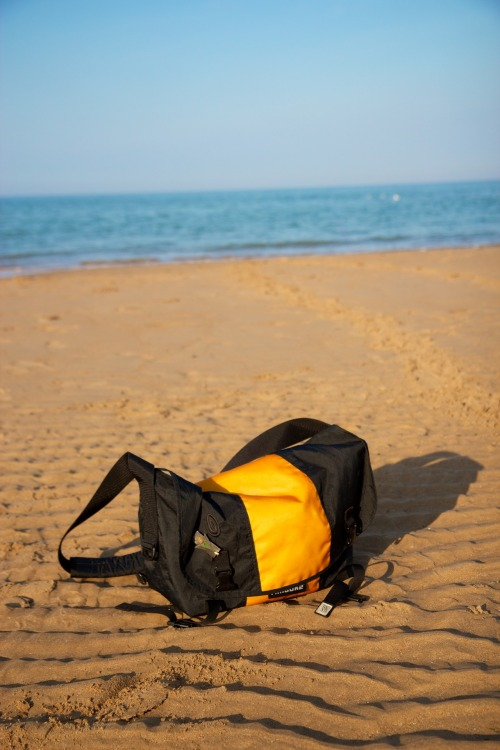 DUUUUUUUDE!  timbuk2fans:  Name: Joe Sterne Place: On Normandy Beach in France, 2011. About this photo: This bag is my first Timbuk2 bag and has been halfway around the world with me.