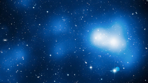 ikenbot:  Giant Strand of Elusive Dark Matter Seen in 3D  Astronomers have taken their first 3D look at a gigantic filament of dark matter, an invisible cosmic structure that can only be detected by its gravitational effects it has on its surroundings.  Image: This enormous image shows Hubble's view of massive galaxy cluster MACS J0717. The large field of view is a combination of 18 separate Hubble images. The location of the dark matter is revealed in a map of the mass in the cluster and surrounding region, shown here in blue. The filament visibly extends out and to the left of the cluster core. Credit: NASA, ESA, Harald Ebeling (University of Hawaii at Manoa) & Jean-Paul Kneib (LAM)   The universe is thought to be structured like a tangled web, with long strings of mostly dark matter intersecting at giant galaxy clusters. Since dark matter cannot be seen directly, these filaments are difficult to observe. But using the Hubble Space Telescope, astronomers have managed to probe one of the elusive cosmic strands in 3D.  The researchers sought out a 60 million light-year strand of dark matter around the massive galaxy cluster MACS J0717. The galaxy cluster is one of the largest yet seen and is about 5.4 billion light-years from Earth.  continue