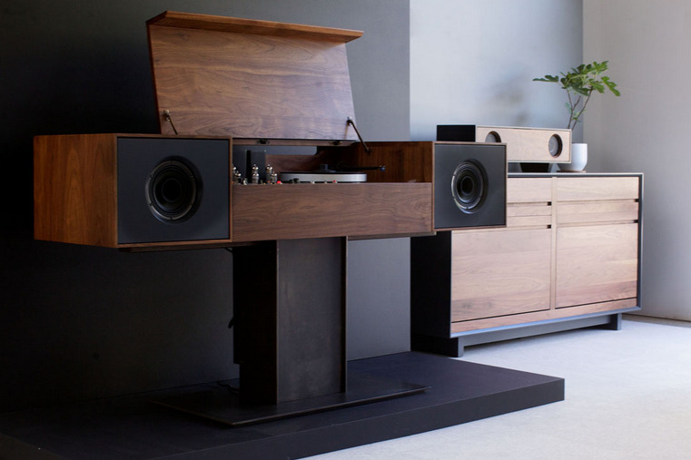 utilitarianthings:  The Modern Record Console is a sound system that pays homage to the all-in-one hifi console of the 1950's. This rendition of the classic machine is capable of playing both old-style records and modern MP3s; it has a built in wireless router that can stream from any digital source.