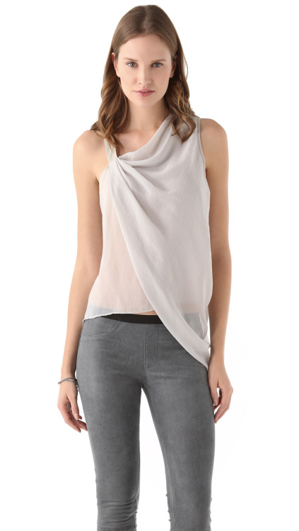 Helmut Lang Lyra Sleeveless Top $335 Fabric: Chiffon.Shell: 100% polyester.Trim: 100% goatskin.Lining: 94% polyester/6% spandex.Dry clean.Made in the USA.