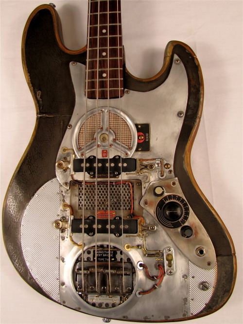 "Smashmouth Bass guitarThis electric bass guitar was played by Philip Endicot, who worked for General Radio back in the late 40's - early 50's. He scavenged parts there like a fat man in a bologna factory. His real passion was a 5 piece jazz band he belonged to called ""Reform School"". This was one of the first jazz groups to go electric in Concord. He would use the pilfered parts on his bass in a quest to find ""smashmouth boom"". Caught stealing red handed at G.R. in '58, he was sent to jail where he died in a fight over cigarettes, non-filtered Pall Malls to be exact. His brother inherited the bass and stuck it in his attic until 1998 when I bought it at his garage sale. It has the ultra rare contactor, a cool dark tone reed, and the infamous type 740 capacitance test bridge that G.R. was supposedly developing for a guy named Leo in Fullerton. (Never proven.) LIKE us at www.facebook.com/TonyCochranGuitars   for details & photos link"