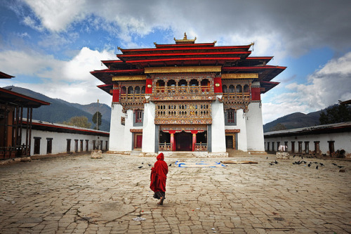 Bhutanese Monk and Monastery by David_Lazar on Flickr.