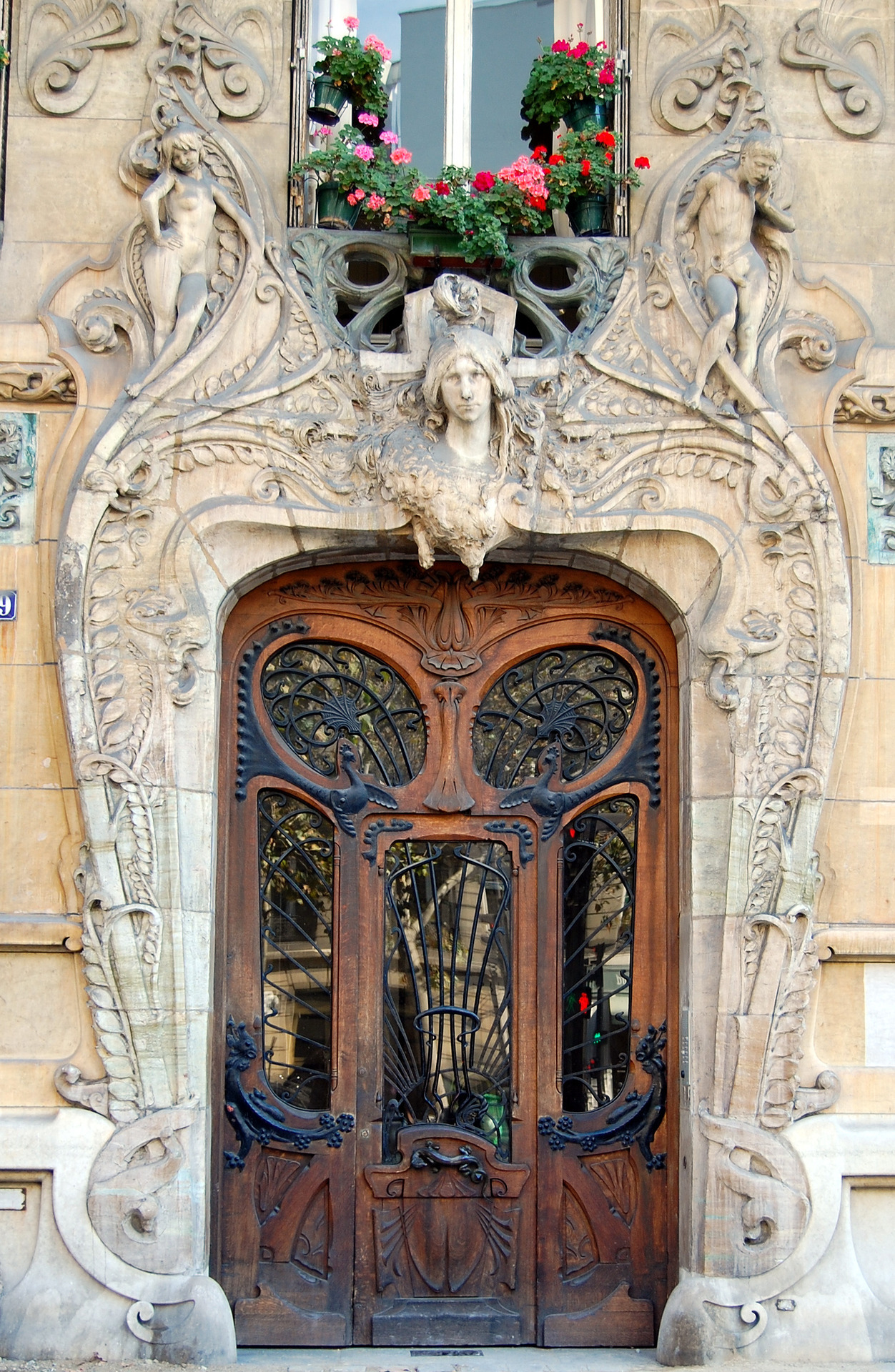 Door of the Art Nouveau Building from the architect Jules Lavirotte, 29 avenue Rapp, Paris 7th district, France. Sculptures by Jean-François Larrivé (1875-1928)