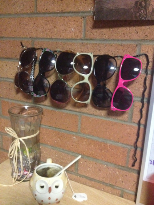Yarn and hot glue make sunglasses storage easy for dorm life. Thought of this little trick on my own!