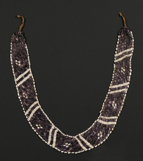 Rare Wampum Shell Necklace, Penobscot, c. first half 19th century or earlier, white and purple shell beads strung on hemp in seven pairs of white diagonal lines, seven white crosses, and white edging on a purple background.