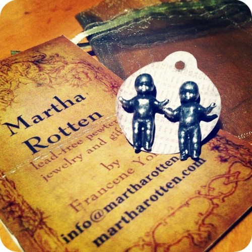 NYCC 2012 swag: Babies earrings, by Martha Rotten. Martha Rotten has been on my jewelry radar ever since Niki posted photos of her collection of pewter baby heads and ornate rings over the past couple of years, so I was absolutely thrilled to see her booth at NYCC this year.