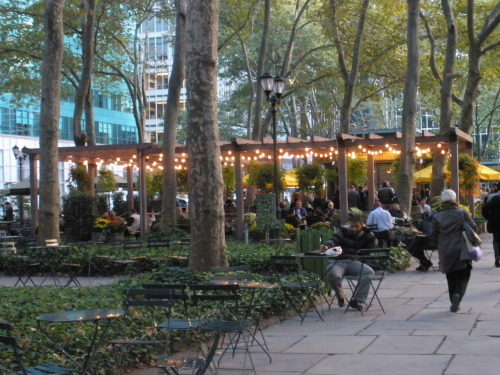 "Late lunch-goers enjoy The Southwest Porch at Bryant Park.  The lights dotting the ""Porch"" look very Christmas-ish to me!"