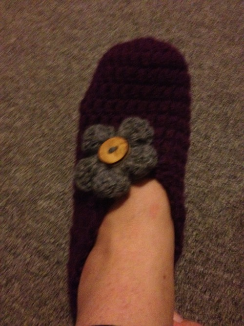 Turns out slippers are not too unlike making a hat - so here is my first pair, and first flower to boot!!  Not a perfect specimen of crochet genius, but not the worst either!