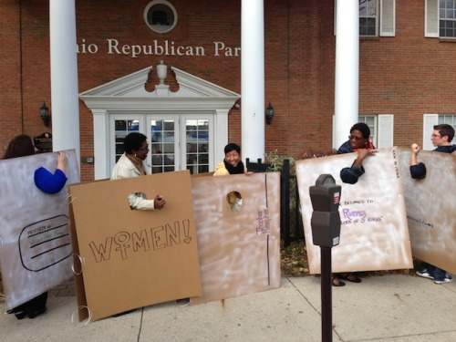 "quickhits:  ""Binders full of women"" protest at Ohio GOP HQ. I'm thinking we may also be looking at a Halloween trend here.  Yup! A friend of mine suggested it as a Halloween costume on Facebook. :) And these asshats in Ohio have a sign on their building? Even in Texas, our local Repubs don't do that."