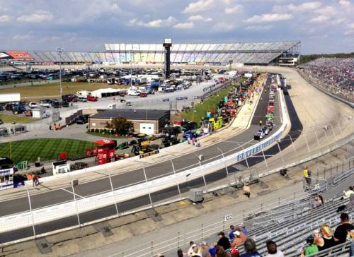 Sparks' excellent photo, from the stands on a sunny day, of the Monster Mile and all the cars in the pit of Dover International Speedway, gives you a great idea of just how vast the track is. In this photo, taken before the Sprint Cup AAA 400 from section 124, you can perfectly see turn 4 and all the activity at pit row. (via Dover International Speedway section 124 row 22 seat 7 shared by sparks)