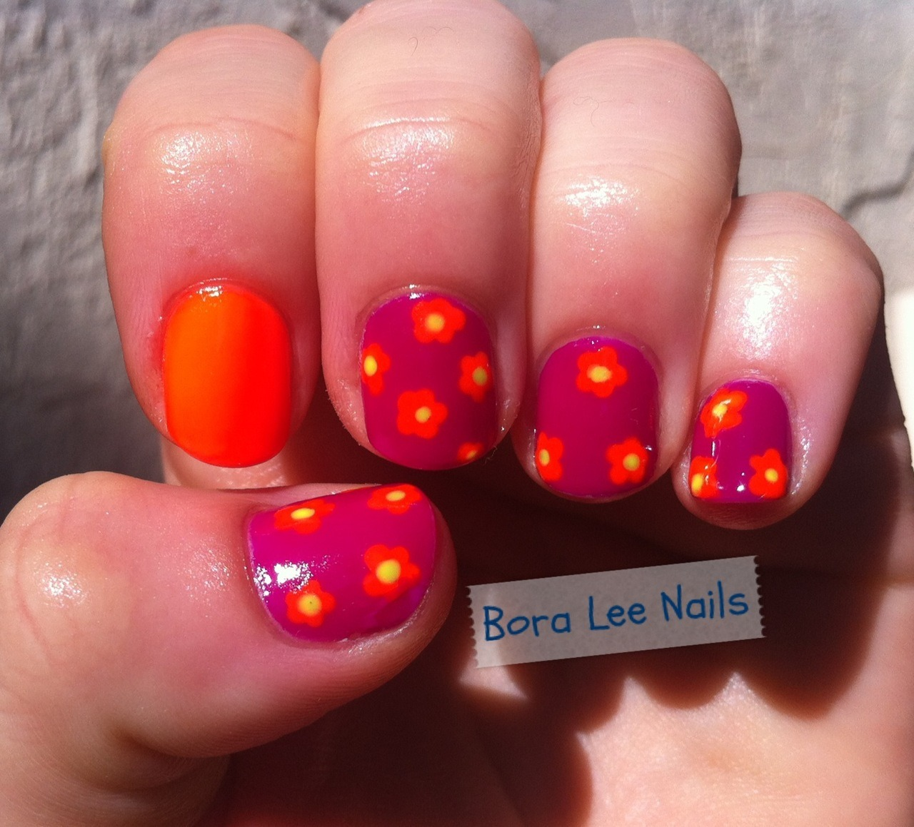 Funky Floral Nails: I love this neon orange! Products used: Nina Ultra Nail Pro: Punki Purple, Solar Flare, Orange Flame