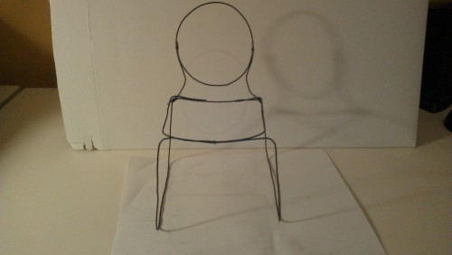 Five minute study in wire frame chair design. Not at all what the finished product will look like, just seeing what would happen when I started bending bailing wire. I am designing a chair with as few components as possible that will cost very little to produce… LONG way to go yet…