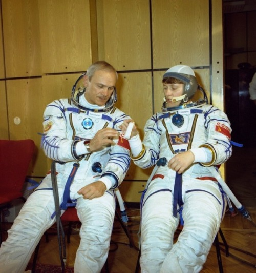 Vladimir Dzhanibekov and Svetlana Savitskaya before the launch of Soyuz T-12. (1984) (Source)