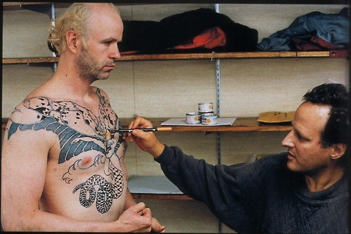 cinephilearchive:  Michael Mann retouches Tom Noonan's tattoos in Manhunter.  Leopard hanging out in its trailer