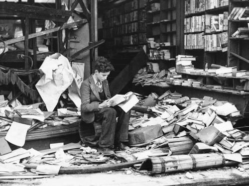 "sixpennybook:  A boy sits amid the ruins of a London bookshop following a 1940 air raid, reading a book titled ""The History of London."" (AP photo, via The Atlantic)"