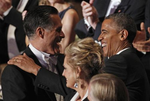 Mitt Romney greets President Barack Obama as Ann Romney looks on at the Alfred E. Smith Memorial Foundation dinner in New York on October 18, 2012. REUTERS/Jim Young