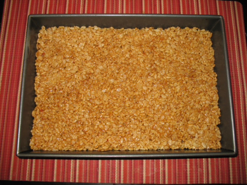 mybakingadventure:  Pumpkin Spice Rice Krispie Treats for Jana's birthday Recipes like this are reason number twenty million for why I love the internet. I told Jana to pick a birthday treat, and she went to my Pinterest board and picked Pumpkin Spice Rice Krispie Treats. So I read the comments under the recipe, and a lot of people were complaining that the squares fell apart because of the moisture created by the pumpkin. And then one person posted that she came up with a solution to get the moisture out of the pumpkin. I followed her link. I followed her advice. I will now follow her blog. And maybe follow her around. First things first, I addressed the pumpkin issue.  I pressed the moisture out of the pumpkin. (Dave thinks this picture makes it look like a diaper. Ew!) I also tried squeezing it out, still holding it in the paper towel. It was gross but satisfying.  And, as described, I ended up with a piece of pumpkin you could hold in your hand.  Then I measured out as much of the other ingredients as I could. Rice Krispie squares are simple, but they're all about timing, and melting. I measured out 6 cups of Rice Krispies.  (Yeah, there's a ton of crap on the counter. It was a very hectic evening.) I also measured out all the spices (except the vanilla): cinnamon (I used a ginormously heaping teaspoon), ginger (generous half teaspoon), cloves, salt, and then I threw in a little pumpkin pie spice as well.  Then I started the process of turning all of this into Jana's birthday present. I melted the butter, and added the piece of pumpkin.  Now let's talk about marshmallows. The recipe required one ten-ounce bag of mini marshmallows. I went to the grocery store to get them and the marshmallow shelf was full of Halloween candy. I inquired about marshmallow availability: what I saw was what they had. And what did they have? S'mores marshmallows. Flat square ones. In 8-ounce bags.  Eek! I bought the only two bags they had, effectively ruining the plans of anyone else in my neighborhood who might want to make Rice Krispie treats.  Then I guestimated the additional two ounces from the second back, and added them to the pan.  I stirred.  Once they were almost done melting, I added the vanilla and spices.  When it had all come together, I removed it from the heat, and let it cool just a little.  And then it was time to add the Rice Krispies.  After some concentrated stirring and pan-scraping, I ended up here:  And then here:  Then I used Paula Deen's wonderful tip about how to flatten sticky items or graham cracker crusts: I sprayed the bottom of a measuring up with cooking spray and used that to push everything down.   Look at how good that is! Thanks to the tip about the pumpkin, everything turned out beautifully. This morning I cut off a little for the kids, and they BOTH loved it. Juliet even asked to bring some to school for snack. It's got all the sweetness of a Rice Krispie square with this wonderful pumpkin spice flavor seeping through as you bite it and lingering after you've finished your bite. Lovely! So hooray for the internet, full of mysterious new recipe ideas, people's experiences making them, and experiments to improve them. Happy birthday Jana! PUMPKIN SPICE RICE KRISPY TREATS RECIPE