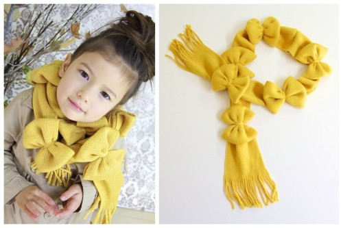 DIY Easy Lots of Bows Scarf Tutorial from Ruffles & Stuff here. A child's scarf takes two Dollar Store Scarves and this DIY is so much easier than it looks. For an adult sized scarf she recommends using three scarves, or using fleece and cutting it to two times your finished length.