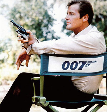 Roger Moore as James Bond: Candid shot of Roger in a 007 chair. For more James Bond & other secret agents visit http://www.pickoftheflicks.com