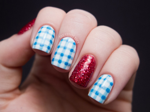 chalkboardnails:  Costume Nails: Dorothy from The Wizard of Oz Wet N Wild Color Icon Rockin' RubiesOPI Alpine SnowOPI What's With the Cattitude?China Glaze Sky High-top