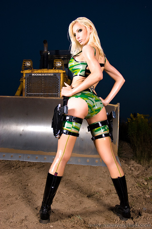 Susan Wayland in Blonde Bombshell in Latex - Camouflage Uniform Full Gallery here