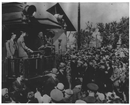 "Campaign Train Stop, 1936  FDR campaigns from back of railroad car ""Pioneer."" October 1936. -from the Roosevelt Library, Photo ID: NPx 61-393"