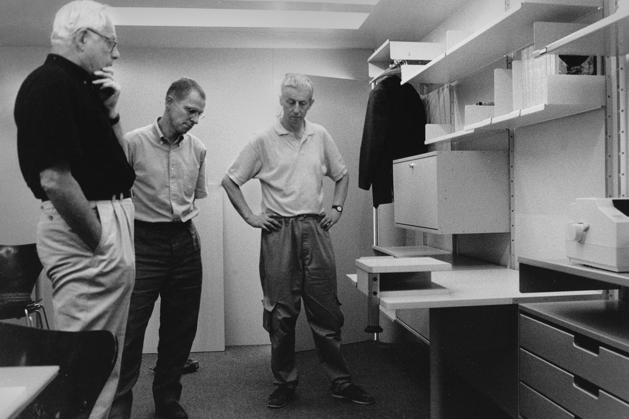 vitsoe:  2001: Dieter Rams, Vitsœ's MD, Mark Adams, and industrial designer, Peter Wheeler, consider carefully the implications of the evolution of 606's integrated table.