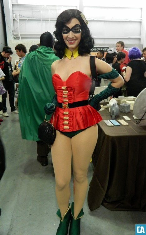 Fashion of New York Comic Con 2012: Robin Holy heartthrob, Batman - check out this amazing Robin-inspired pin-up ensemble in Artist Alley on Saturday afternoon! I love how she refashioned the laces on Robin's tunic into bows and simplified the cape into a chic detachable collar.