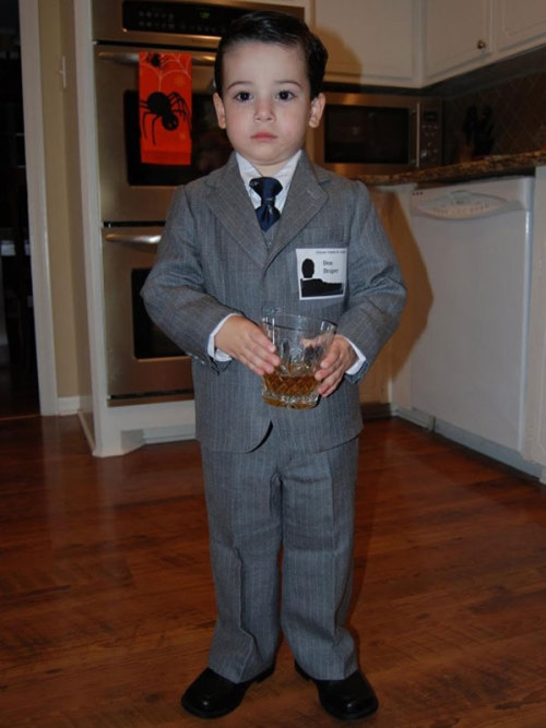 thedailywhat:  flavorpill:  Halloween costumes that kids are far too young to understand   Parents these days.  You guys: attention to detail is IMPORTANT. If you're gonna make your kid play dress up for you, at least have the decency to recognize that Don never - never - wears 1) pinstripes or 2) a 3-piece suit. Those things are firmly in Roger's sartorial territory. Geez. Amateur hour. Get it together, parents.