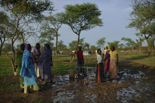"doctorswithoutborders:  Photo:Women gather at a water tap in T3, the temporary transit site for new arrivals near Jamam. South Sudan 2012 © Shannon Jensen  When the Tap Runs DryOn Thursday, the pumps at the Bamtiko borehole—the main source of water for Jamam refugee camp—had failed. Imran, MSF's water and sanitation specialist, led his team in a quick emergency response to replenish and treat the water supply.  ""By the time evening came around that first wet day, I was covered in mud, exhausted, hungry, my clothes bleached by spilled chlorine — a day well-lived. I'm looking forward to doing it again,"" says Imran. Read more from his blog on ensuring water treatment in South Sudan."