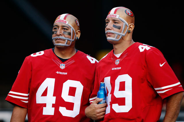 Fans of the 49ers enjoy Thursday's 13-6 victory over the Seahawks. With the victory, San Francisco climbed into first place in the NFC West. (Brian Bahr/Getty Images) TROTTER: Smith, 49ers roll to victory over SeahawksVIDEO: Biggest weakness of the NFL's top teams
